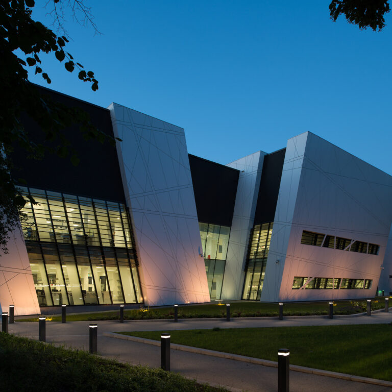 Exterior of the Oglesby Cancer Research Building at nighttime