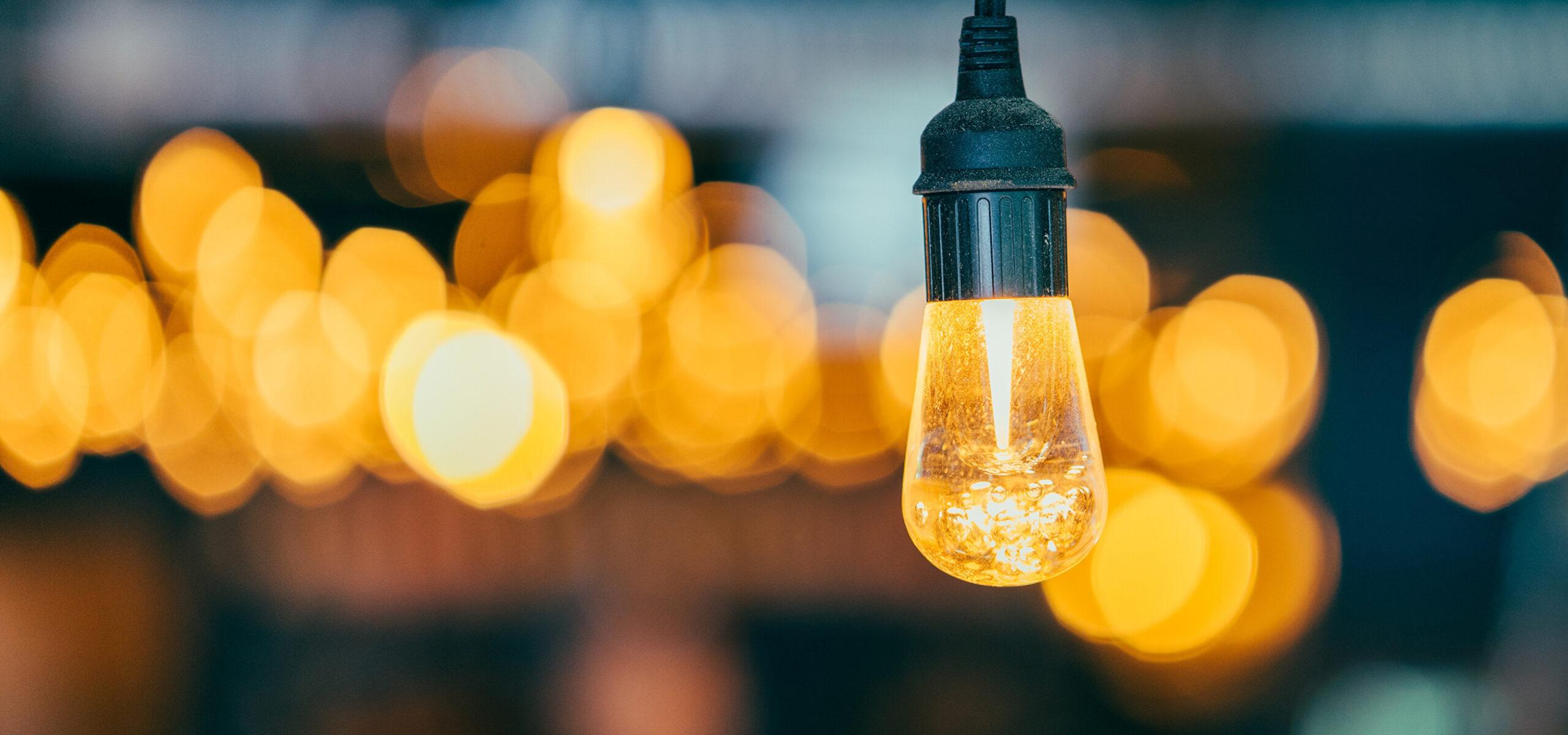 Light bulb against dark background