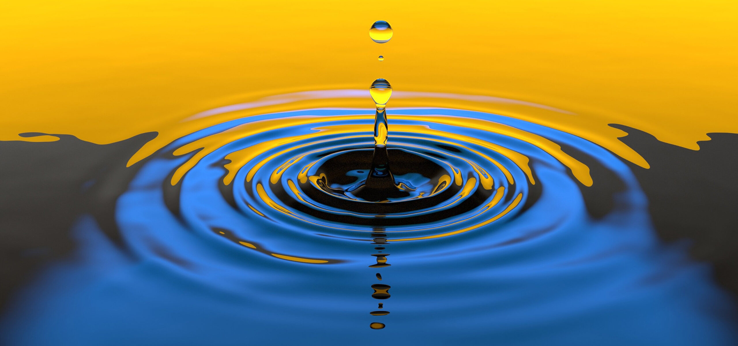 Drop of water causing ripples in water